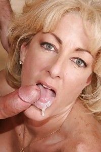 Blonde mom Milan Summer having fun with her bubble jugs and takes spunk showering in her face